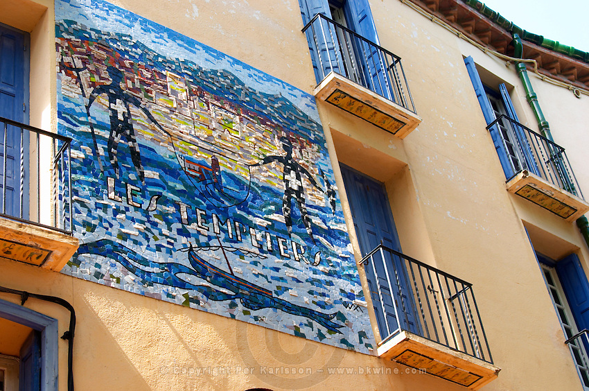 Mosaic Sign at the legendary Templier hotel and restaurant. bright blue hotel room window shutters. Collioure. Roussillon. France. Europe.