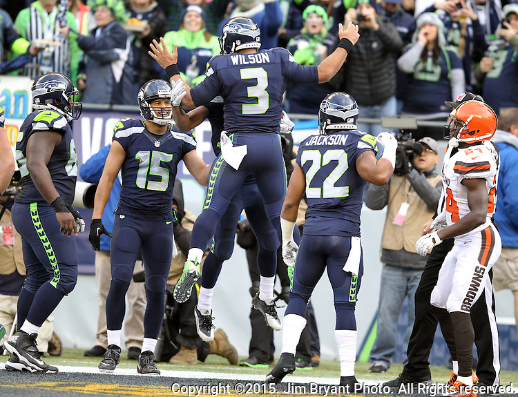 Seattle Seahawks wide receiver Tyler Lockett (16) celebrates with Russell Wilson (3) after catching a 27-yard touchdown against Cleveland Browns defensive back Johnson Bladesmosi (24) at CenturyLink Field in Seattle, Washington on December 20, 2015. The Seahawks clinched their fourth straight playoff berth in four seasons by beating the Browns 30-13.  ©2015. Jim Bryant Photo. All Rights Reserved.