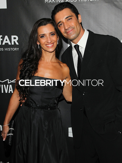 HOLLYWOOD, LOS ANGELES, CA, USA - OCTOBER 29: Carole Marini, Gilles Marini arrive at the 2014 amfAR LA Inspiration Gala at Milk Studios on October 29, 2014 in Hollywood, Los Angeles, California, United States. (Photo by Celebrity Monitor)