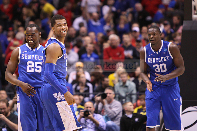 Dominique Hawkins, Andrew Harrison and Julius Randle celebrate after UK defeated Louisville at the NCAA Sweet 16 vs. UofL at the Lucas Oil Stadium in Indianapolis , Ind., on Friday, March 28, 2014. Photo by Emily Wuetcher | Staff