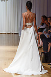 Model walks runway in an Imogen gown from the Casablanca Bridal collection at the Casablanca Bridal 20th anniversary celebration runway show, on October 8, 2017; during New York Bridal Fashion Week Spring 2018.
