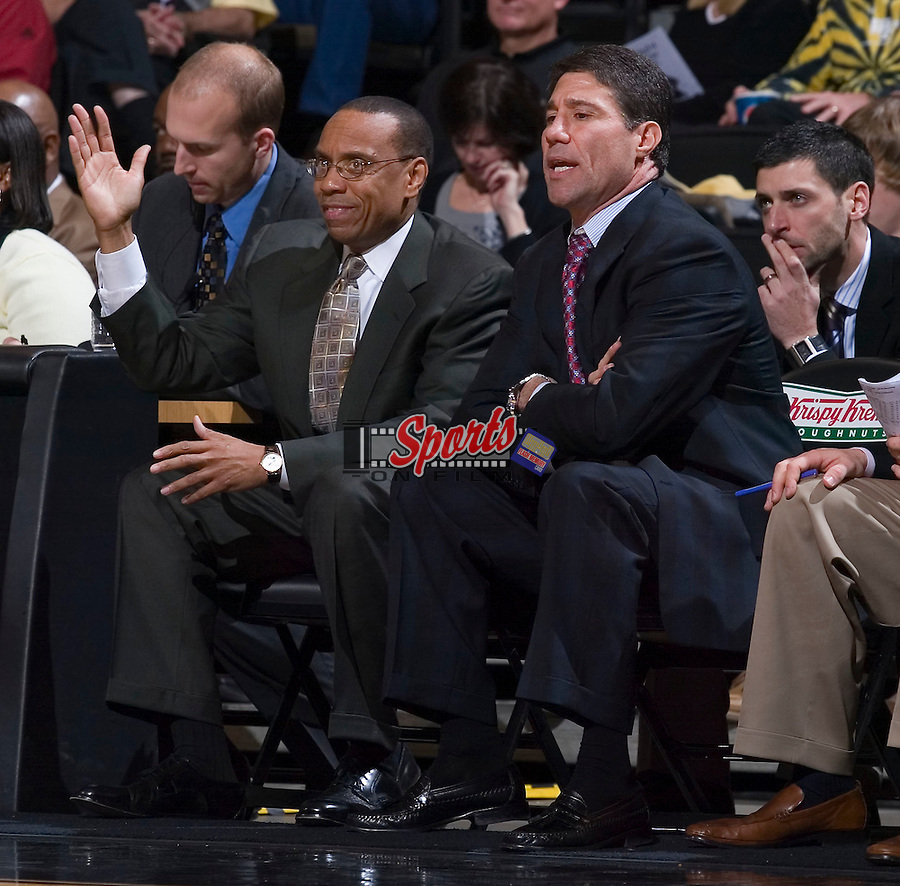 Wake Forest Demon Deacons assistant coach Jeff Battle (left) and head coach Dino Gaudio give instructions to their team during second half action versus the Radford Highlanders at the LJVM Coliseum December 30, 2008 in Winston-Salem, NC. (Photo by Brian Westerholt / Sports On Film)