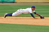 Northwest Arkansas Naturals second baseman Carlos Diaz (2) dives for a ground ball during a game against the Frisco RoughRiders at Arvest Ballpark on May 24, 2017 in Springdale, Arkansas.  Frisco won 8-5.  (Dennis Hubbard/Four Seam Images)
