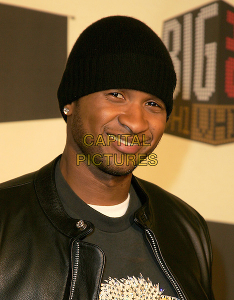 USHER.The VH1 Big in 04  Award Show held at The Shrine Auditorium in Los Angeles, California .December 1, 2004.headshot, portrait, hat, beanie, facial hair, stubble.www.capitalpictures.com.sales@capitalpictures.com.Supplied by Capital Pictures