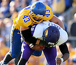 BROOKINGS, SD - OCTOBER 24:  Jared Blum #43 from South Dakota State brings down quarterback Aaron Bailey #15 from University of Northern Iowa in the second quarter of their game Saturday afternoon at Coughlin Alumni Stadium in Brookings. (Photo by Dave Eggen/Inertia)