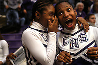 Cheerleaders Ashley Barnes and Carla Armstrong exchange gossip during a high school basketball game at Muncie Central.