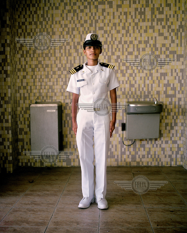 Cadet Melissa Galvez at the Panamanian Navy School in La Boca. The building once contained the Florida State University of Panama. The first campus was established in 1957 and served as an academic institution where U.S. military and civillians located in the Panama Canal Zone could continue their education. The campus had various locations in Panama City, but was, for many years, located in La Boca (The Mouth). <br /> <br /> The Panama Canal Zone is an area extending 8kms out, in each direction, from the waterway's central line, was a territory controlled by the United States between 1903 and 1979. After a 20 year period of joint administration, the Canal came under the full control of Panama in 1999. The Canal opened to shipping in 1914 and during its tenure was of great strategic importance to the US, enabling it to rapidly move its naval fleet between the Atlantic and Pacific Oceans. However, its economic value came not directly from shipping fees but from the stimulus to trade that the waterway created. One hundred years after it opened in 2014 it is due to have its locks upgraded to cater for the super sized container ships of the 21st Century.  <br /> During the era of American administration thousands of US citizens populated the Canal Zone, living and working under US law in towns built to American standards. Not all of these people returned north after the canal came under full Panamanian control many stayed on, their identities tied to the region.