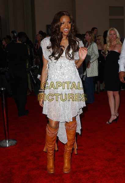 CIARA.The 33rd Annual American Music Awards held at The Shrine Auditorium in Los Angeles, California.  .November 22nd, 2005.Ref: DVS.AMA's full length white dress lace brown boots.www.capitalpictures.com.sales@capitalpictures.com.Supplied By Capital PIctures