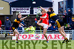 David Clifford, East Kerry in action against Gavin O'Shea and Michael Moloney, Dr Crokes  during the Kerry County Senior Club Football Championship Final match between East Kerry and Dr. Crokes at Austin Stack Park in Tralee, Kerry.