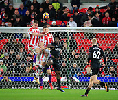 2nd December 2017, bet365 Stadium, Stoke-on-Trent, England; EPL Premier League football, Stoke City versus Swansea City; Ryan Shawcross of Stoke City heads clear under pressure from Wilfried Bony of Swansea City