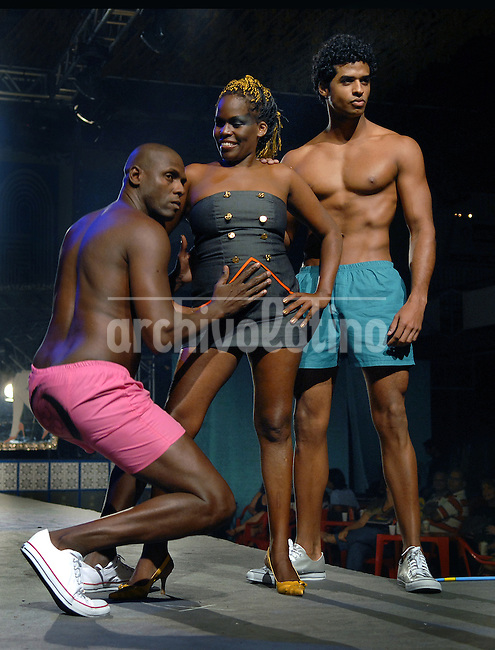 Prostitute Jane Lucia Eloy, center, and two models display creations from the Daspu Spring/Summer 2008-2009 collection during the Off Fashion Rio Show, Rio de Janeiro, Brazil June 12, 2008..Daspu was founded and run by prostitutes organizated by the non-profit organization Davidda, which its founders claim works towards legalizing prostitution, helps prostitutes defend themselves against prejudice and educates them on sexually-.transmitted diseases, presented the first three creations of their fashion label 'Daspu', designed for the prostitutes. . (Austral Foto/Renzo Gostoli)