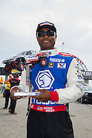 Aug 30, 2014; Clermont, IN, USA; NHRA top fuel dragster driver Antron Brown at driver introductions for the Traxxas Shootout during qualifying for the US Nationals at Lucas Oil Raceway. Mandatory Credit: Mark J. Rebilas-USA TODAY Sports