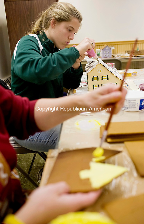MIDDLEBURY, CT--28 November 07--112807TJ02 - Amanda Gilnack, 16, from Naugatuck, adds frosting details to a gingerbread house as her mother, Deb, paints the side of a house during preparations for the 40th Anniversary Gingerbread Village at St. George's Episcopal Church in Middlebury on Wednesday, November 28, 2007. T.J. Kirkpatrick/Republican-American