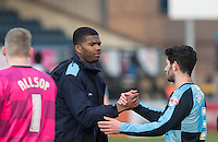Rowan Liburd of Wycombe Wanderers shakes hands with Joe Jacobson of Wycombe Wanderers post match during the Sky Bet League 2 match between Wycombe Wanderers and Stevenage at Adams Park, High Wycombe, England on 12 March 2016. Photo by Andy Rowland/PRiME Media Images.