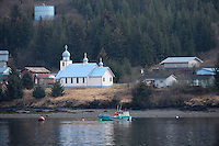 The Russian Orthodox Church in the Native village of Tatitlek, in Prince William Sound, Southcentral Alaska is lit by the morning sun on a spring day in early May.