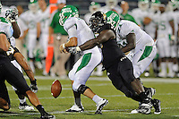 1 September 2011:  FIU's Gregory Hickman (55) causes North Texas' Derek Thompson (7) to fumble the ball in the second half as the FIU Golden Panthers defeated the University of North Texas, 41-16, at University Park Stadium in Miami, Florida.