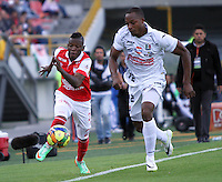 BOGOTA -COLOMBIA. 04-05-2014. Jefferson Cuero  (Izq)  de Independiente Santa Fe disputa el balon  contra Marino Garcia del  Once Caldas partido de Vuelta de Los Cuartos de Final de  La Liga Postobon  jugado en el estadio El Campin .  Jefferson Cuero(L) of Independiente Santa Fe dispute the balloon against Once Caldas Marino Garcia  Party Spin The Quarterfinals La Liga Postobon played at El Campin. Photo: VizzorImage / Felipe Caicedo / Staff