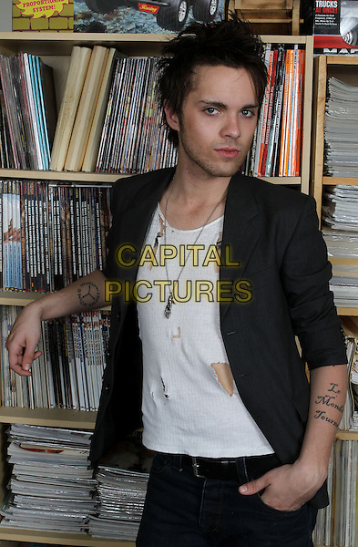 "THOMAS DEKKER .""All About Evil"" cast exclusive photo shoot, Los Angeles, California, USA..March 28th, 2010.half length suit jacket t-shirt ripped torn tattoos grey gray stubble facial hair.CAP/ADM/SM/GW.©Glenn Weiner/ Stargaze Media/AdMedia/Capital Pictures."