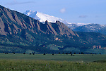 Flatirons formations in foothills w/ Mt Meeker & Longs Peak in background, near Boulder, CO