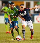 Seattle Sounders Lamar Neagle (27)  controls the ball against New England Revolution Kevin Alston (30) during an MLS match on March 8, 2015 in Seattle, Washington.  The Sounders beat the Revolution 3-0.  Jim Bryant Photo. ©2015. All Rights Reserved.