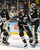Brendan Leahy (PC - 1), Mark Jankowski (PC - 10), Jon Gillies (PC - 32) - The Providence College Friars defeated the Boston University Terriers 4-3 to win the national championship in the Frozen Four final at TD Garden on Saturday, April 11, 2015, in Boston, Massachusetts.