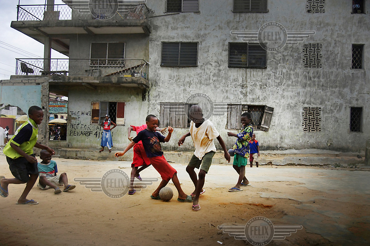 Children play football in the Ajegunle slum. The building behind bears a warning that 'this house is not for sale', and that anyone who claims to be selling it is committing fraud - '419' in local parlance. Nigeria is notorious for its spate of '419' crime, which refers to an article in the country's criminal code outlawing junk email fraud. Such scams, in which foreigners are promised a share of non-existent fortunes, are estimated to be one of Nigeria's largest foreign currency earners.