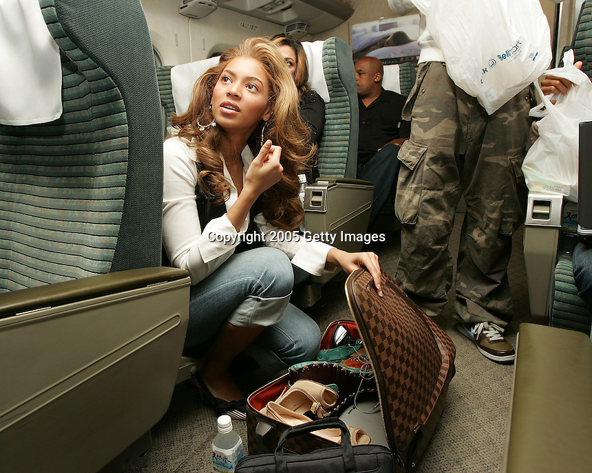 """NAGOYA, JAPAN- APRIL 12: Singer Beyonce Knowles of Destiny's Child on the train from Osaka to Nagoya after the second night of the """"Destiny Fulfilled..And Lovin It"""" 2005 world tour in Osaka, April 12, 2005 in Nagoya, Japan.  (Photo by Frank Micelotta/Getty Images)."""