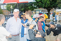 Former Mass. governor Bill Weld, a Republican presidential candidate, speaks to people before speaking at the Political Soapbox on a rainy day at the Iowa State Fair in Des, Moines, Iowa, on Sun., Aug. 11, 2019.
