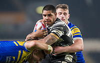 Picture by Allan McKenzie/SWpix.com - 19/04/2018 - Rugby League - Betfred Super League - Hull FC v Leeds Rhinos - KC Stadium, Kingston upon Hull, England - Hull FC's Albert Kelly is tackled by Leeds's Joel Moon and Stevie Ward.