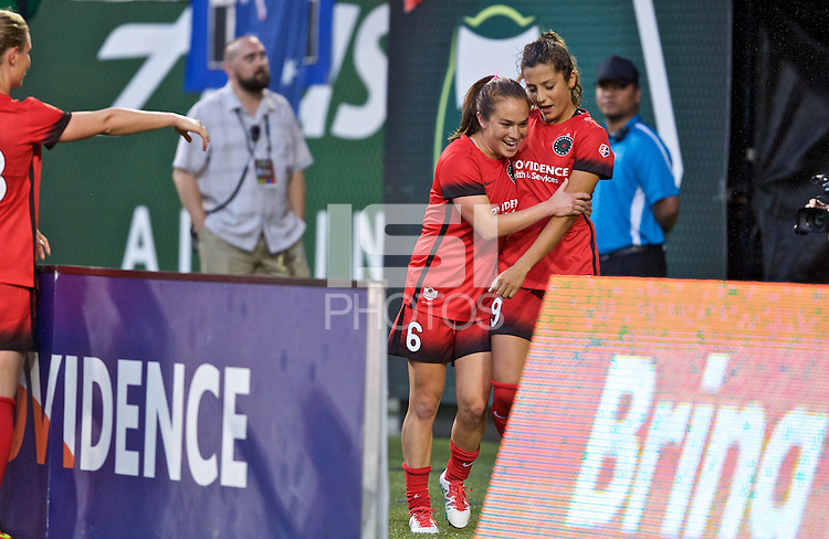 Portland, Oregon - Saturday July 2, 2016: Portland Thorns FC forward Nadia Nadim (9) and Portland Thorns FC midfielder Meleana Shim (6) celebrate after making a penalty kick during a regular season National Women's Soccer League (NWSL) match at Providence Park.