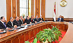 Egyptian President Abdel Fattah al-Sisi meets with the new cabinet ministers at the presidential palace in Cairo, Egypt, in this September 19, 2015 handout picture courtesy of the Egyptian Presidency. Al-Sisi kept his finance, investment and interior ministers in a new government sworn in on Saturday as he tries to rebuild an economy battered by Islamist militant violence. Photo by Egyptian President Office