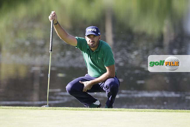 Gregory Havret (FRA) lines up his putt on the 4th green during Thursday's Round 1 of the 2014 Open de Espana held at the PGA Catalunya Resort, Girona, Spain. Wednesday 15th May 2014.<br /> Picture: Eoin Clarke www.golffile.ie