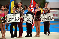 Team member of USA Senior Group waves holds flag during opening ceremony at 2007 Genoa World Cup of Rhythmic Gymnastics Groups on June 9, 2007 at Genoa, Italy.  (Photo by Tom Theobald)