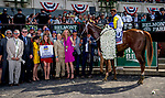ELMONT, NY - JUNE 09: The connections of #10 Bee Jersey celebrate their victory in the Runhappy Metropolitan Handicap on Belmont Stakes Day at Belmont Park on June 9, 2018 in Elmont, New York. (Photo by Eric Patterson/Eclipse Sportswire/Getty Images)