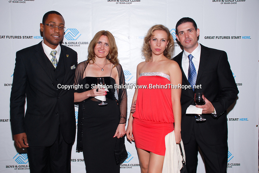 Stonley Baptiste, Solange Fink, Olga Solomenko, and Alejandro Dasilva attend The Boys and Girls Club of Miami Wild About Kids 2012 Gala at The Four Seasons, Miami, FL on October 20, 2012