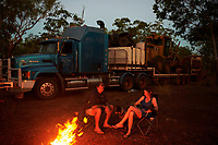 Nick and Joanna Atkins, with their dog Lin, sit by the campfire after a day of driving the Gibb River-Kalumburu Road. ''We aren't rich, but we are always on holidays'', says Joanna.