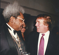 CelebrityArchaeology.com<br /> 1992 FILE PHOTO<br /> Donald Trump & Don King<br /> Photo By John Barrett-PHOTOlink.net<br /> -----<br /> CelebrityArchaeology.com, a division of PHOTOlink,<br /> preserving the art and cultural heritage of celebrity<br /> photography from decades past for the historical<br /> benefit of future generations, for these images are<br /> significant, both historically and aesthetically.<br /> ——<br /> Follow us:<br /> www.linkedin.com/in/adamscull<br /> Instagram: CelebrityArchaeology<br /> Blog: CelebrityArchaeology.info<br /> Twitter: celebarcheology