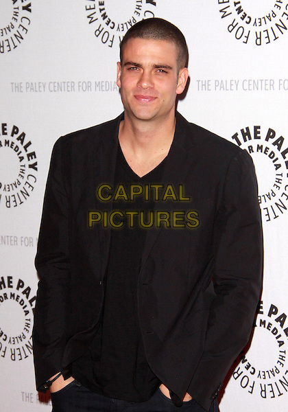 "MARK SALLING.27th Annual Paley Fest  presents  ""Glee""  held at the Saban Theatre, Beverly Hills, California, USA..March 13th, 2010.half length brown suit jacket black .CAP/ADM/TC.©T. Conrad/AdMedia/Capital Pictures."