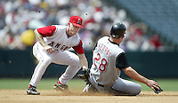 David Eckstein of the Los Angeles Angels tags a sliding Austin Kearns of the Cincinnati Reds during a 2002 MLB season game at Angel Stadium, in Anaheim, California. (Larry Goren/Four Seam Images)