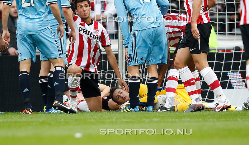Nederland, Eindhoven, 18 september 2011.Eredivisie .Seizoen 2011-2012.PSV-Ajax.Przemyslaw Tyton, keeper (doelman) van PSV komt in botsing met ploeggenoot Timothy Derijck (r)