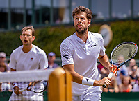 London, England, 5 July, 2019, Tennis,  Wimbledon, Men's doubles: Robin Haase (NED) and Frederik Nieldsen (DEN) (L)<br /> Photo: Henk Koster/tennisimages.com