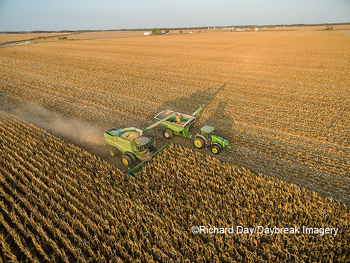 63801-08301 Corn Harvest, John Deere combine unloading corn into grain cart while harvesting - aerial Marion Co. IL