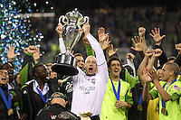 Kasey Keller (18 )of the Seattle Sounders FC holds up the Lamar Hunt Trophy. The Seattle Sounders FC defeated the Columbus Crew 2-1 during the US Open Cup Final at Qwest Field in Seattle,WA, on October 5, 2010.