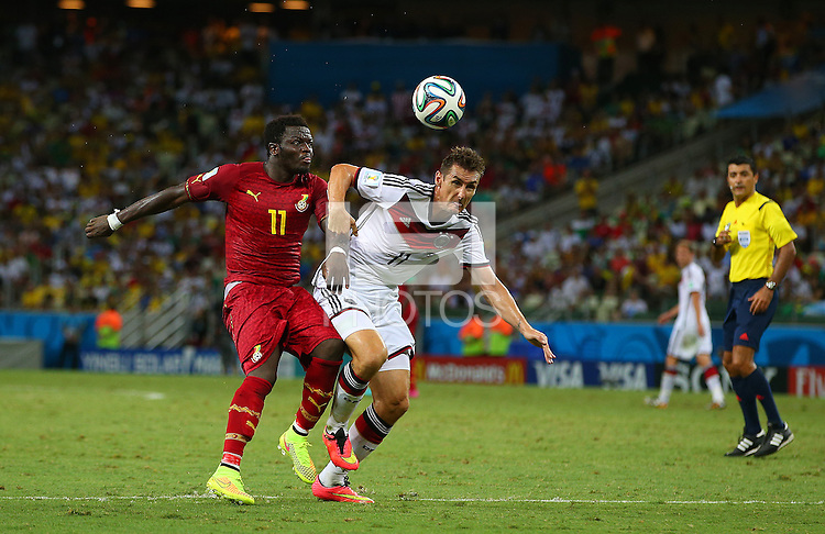 Sulley Muntari of Ghana and Miroslav Klose of Germany in action