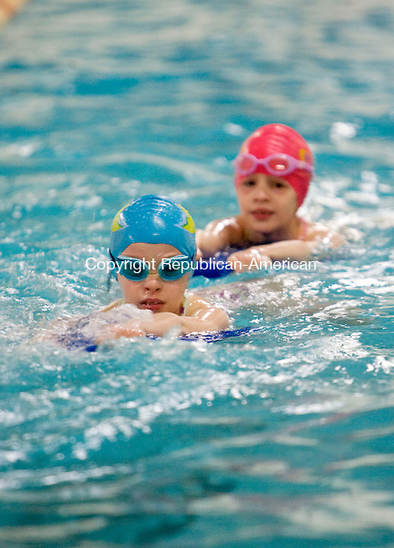 WINSTED, CT - 18 MARCH 2009 -031809JT02-<br /> Twins Cassidy Stotler, left, and Kelly, 7, practice at the Winsted YMCA pool on Wednesday with other members of the Laser swim team before a pizza party to celebrate their upcoming trip to a swim competition in Boston this weekend. Also among the swim team are the Stotler twins' three older sisters, Casey, 12, Kiley, 10, and Mackenzie, 8. Four members of the same team, Brendan Murphy, Eric Traub, Ray Cswerko, and Eric Krupa, will be competing in Ft. Lauderdale, Fla. from April 6 to 9.<br /> Josalee Thrift Republican-American