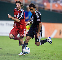 Dwayne De Rosario (7) of D.C. United sprints past Torsten Frings (22) of Toronto FC during the game at RFK Stadium in Washington, DC.  D.C. United tied Toronto FC, 3-3.