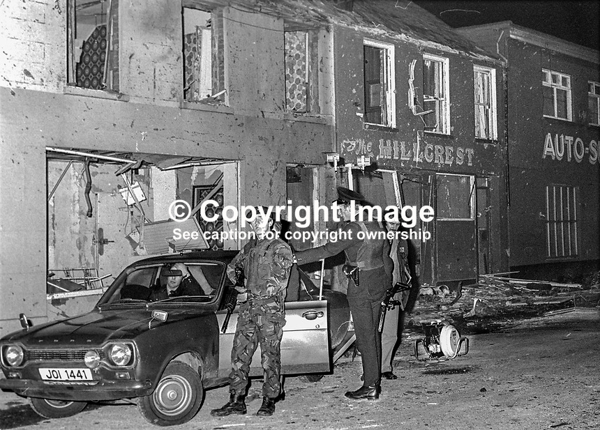 Army and police presence at scene of car bomb explosion at the Hillcrest Bar, Dungannon, Co Tyrone, N Ireland, on St Patrick's Day, 17th March 1976.  It is believed the explosion was the work of the UVF. Four died in the blast, two of whom were schoolboys who happened to be passing at  the time. 197603170158..Copyright Image from Victor Patterson, 54 Dorchester Park, Belfast, United Kingdom, UK...For my Terms and Conditions of Use go to http://www.victorpatterson.com/Victor_Patterson/Terms_%26_Conditions.html