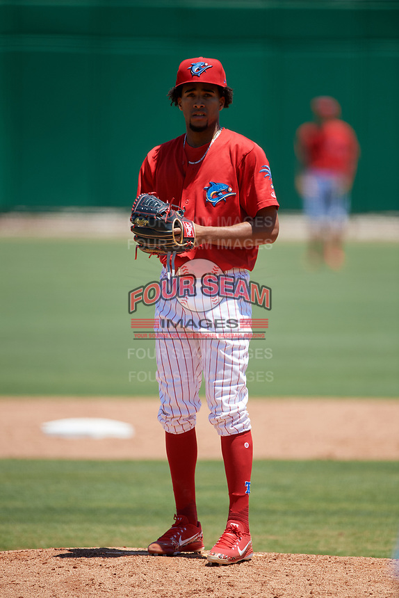 Clearwater Threshers starting pitcher Adonis Medina (18) looks in for the sign during a game against the Fort Myers Miracle on April 25, 2018 at Spectrum Field in Clearwater, Florida.  Clearwater defeated Fort Myers 9-5. (Mike Janes/Four Seam Images)