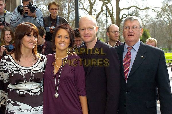 GUEST, LACEY TURNER, JAKE WOOD & DEREK MARTIN.Arrivals at the Television & Radio Industries Club (TRIC) Awards at Grosvenor House, London, UK..March 6th, 2007.half length purple top jeans denim black suit pattern dress.CAP/CAN.©Can Nguyen/Capital Pictures