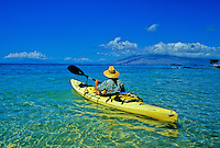 Kayaker paddles off Maui